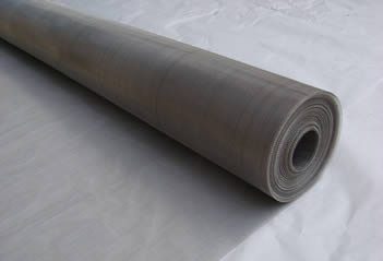 A roll of 304Q stainless steel wire mesh on a piece of paper