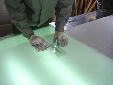 A man is testing a stainless steel mesh