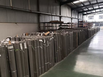 Stainless steel wire cloth rolls in warehouse