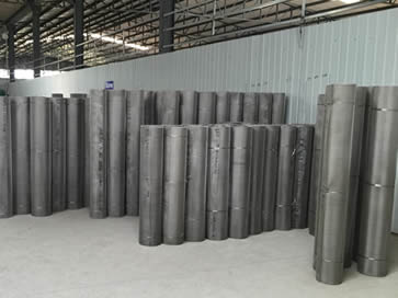 Stainless steel mesh rolls in warehouse